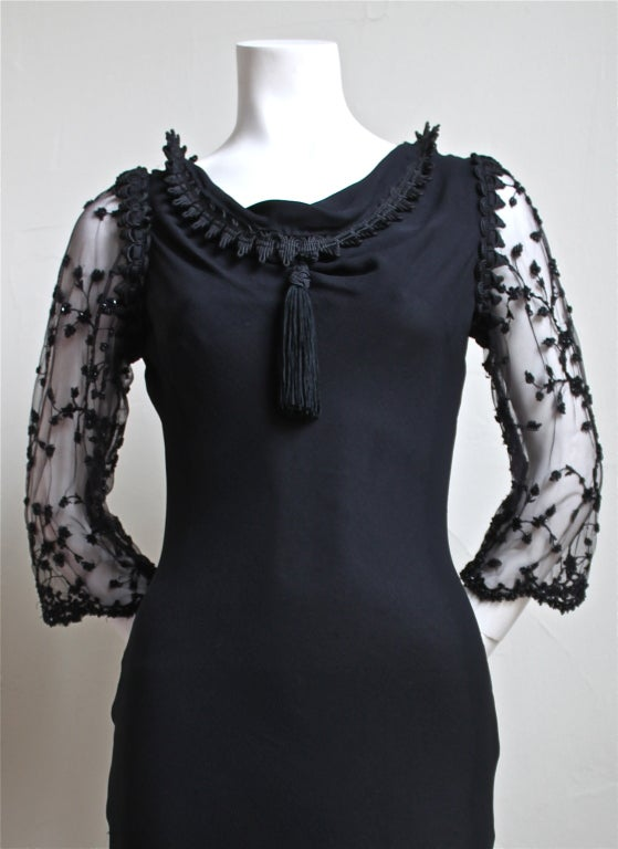 Jet black rare bias cut silk mousseline gown with elaborate beading  and front draped neckline complete with tassel from Yves Saint Laurent dating to the late 1990's. Labeled a French size 36 however there is some give due to the bias cut. Made in