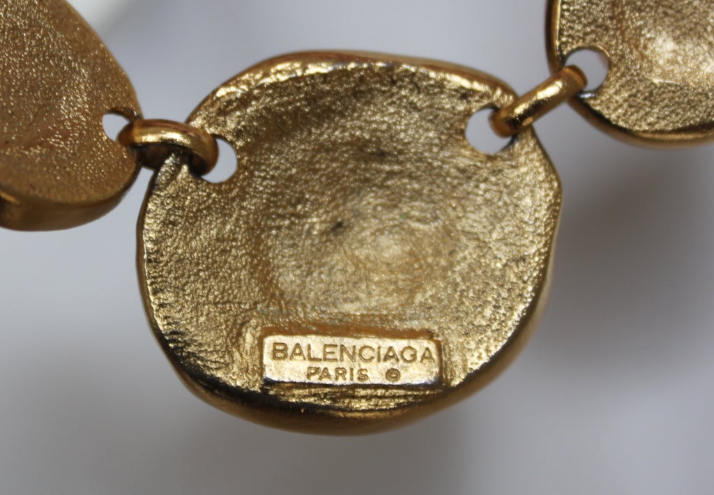 Very unusual asymmetrical gilt necklace with clear glass crystals from Balenciaga dating to the 1980's. Necklace measures approximately 16