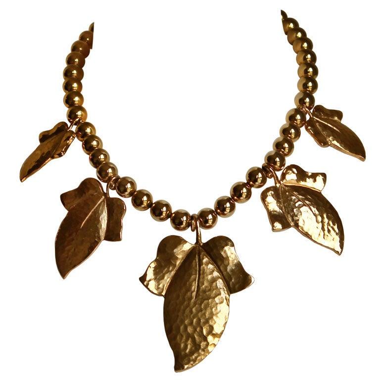 YVES SAINT LAURENT oversized hammered gilt leaf necklace 1