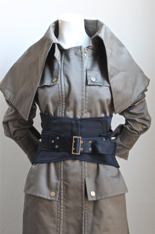 5fc7e5db110 Olive khaki cotton sateen trench coat with black corset belt designed by  Tom Ford for Gucci