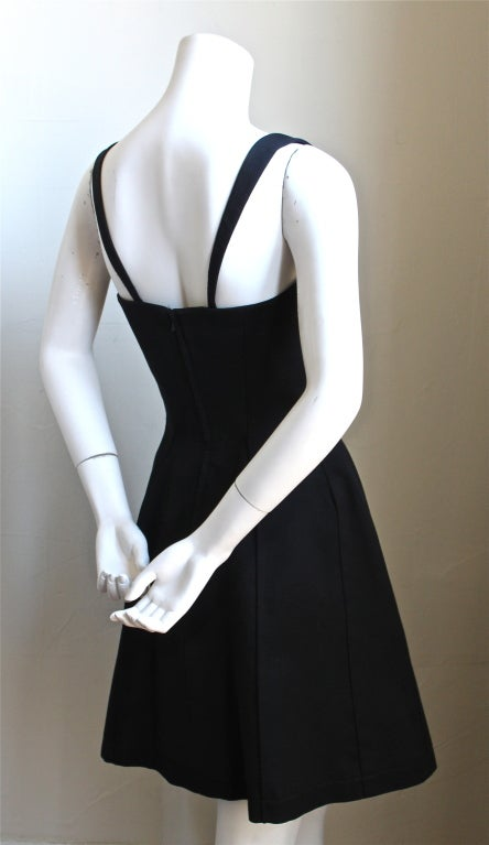 Black cotton piqué flared dress with seaming from Thierry Mugler dating to the 1990's. Labeled a French size 38, which best fits a US 4 or 6.  Back zip closure. Made in France. Excellent condition. WAS $850, Now $550.