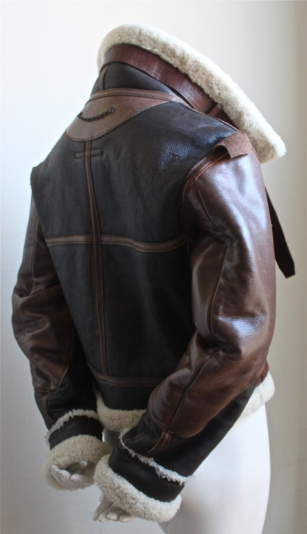 "Very rare aviator shearling coat from Balenciaga dating to Fall 2003. Exact jacket as seen on the runway. Fits a size 4-6. Approximate measurements: semi-dropped shoulder 18"", 36"" bust, 25"" arm length and 20"" overall length w/o collar (26"" w/"