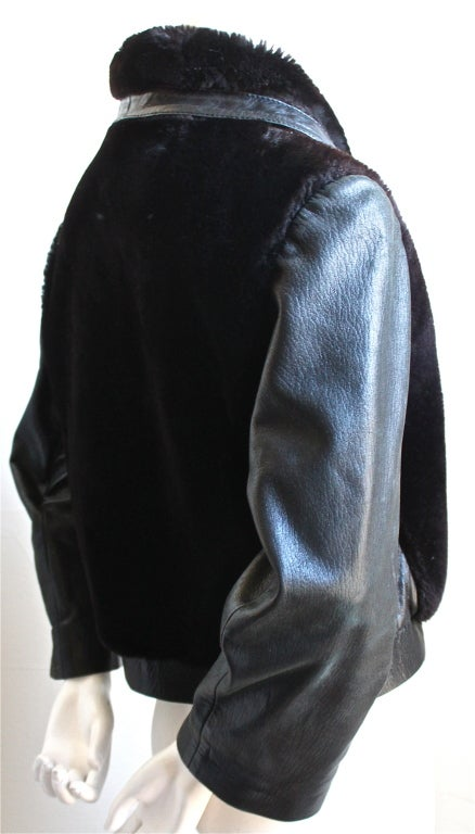 Black leather and dark brown shearling coat from Pierre Cardin dating to the 1960's. Large brass O-ring zipper with silver square snap closure at bottom. Jacket would best a size medium. Fully lined. Made in France. Very good/excellent condition.
