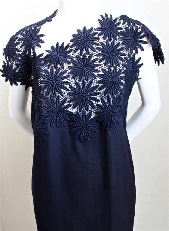 "Very unusual navy blue light weight wool dress with asymmetrically embroidered lace neckline from Comme des Garcons as seen on Yasmin Le Bon on the spring 1990 runway. Size 'S'. Dress measures approximately 38"" at bust, 38"" at hips and"