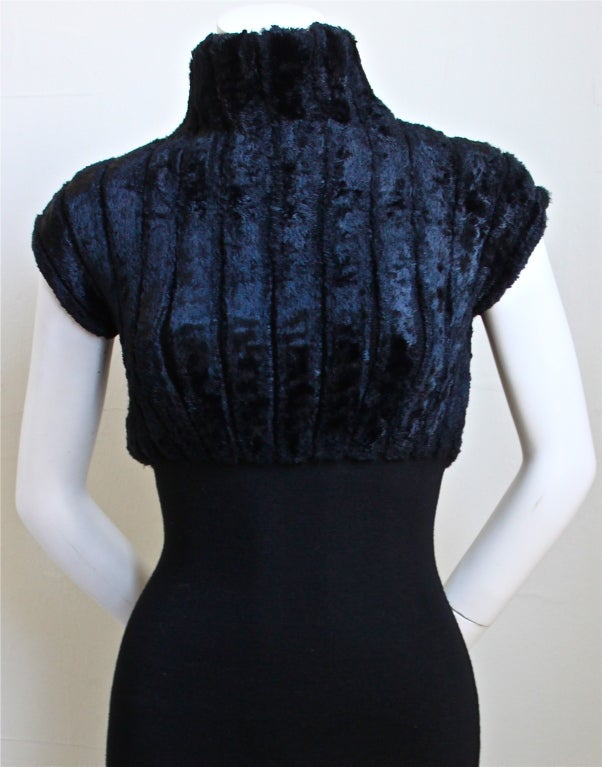 Very rare jet black ribbed chenille dress from Azzedine Alaia dating to 1991. Labeled a size XS. Made in Italy. Hidden back zipper entry. Excellent condition.
