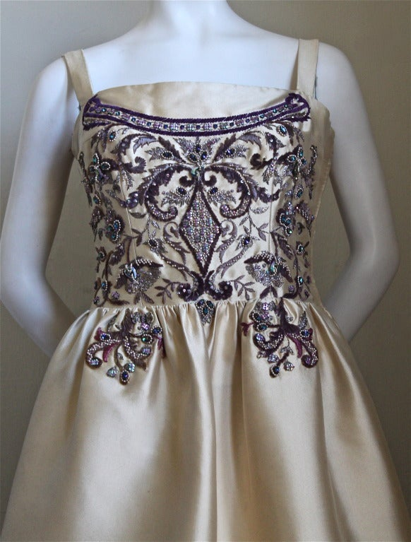 Extremely rare champagne silk gown with chenille and diamante embroidery designed by Antonio del Castillo for the couture house of Lanvin dating to 1957. Intricate embroidery and beadwork was done by the house of Lesage. Phenomenal attention to