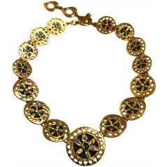 Yves Saint Laurent vintage gilt necklace with blue enamel and glass stone