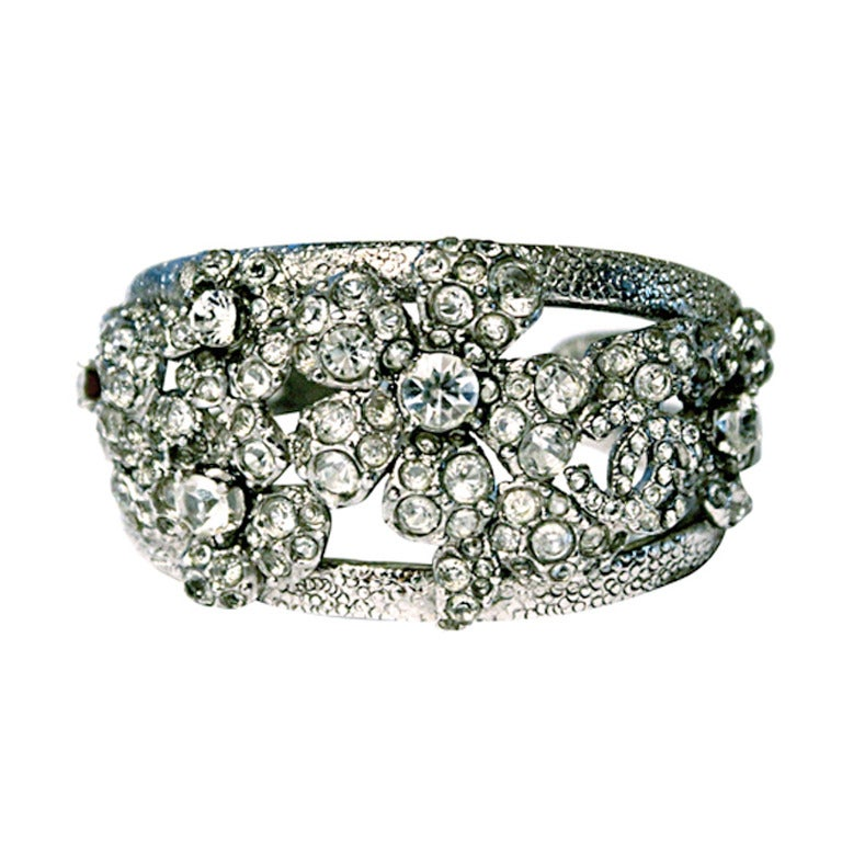 CHANEL floral cuff bracelet with 'CC' and crystals 1