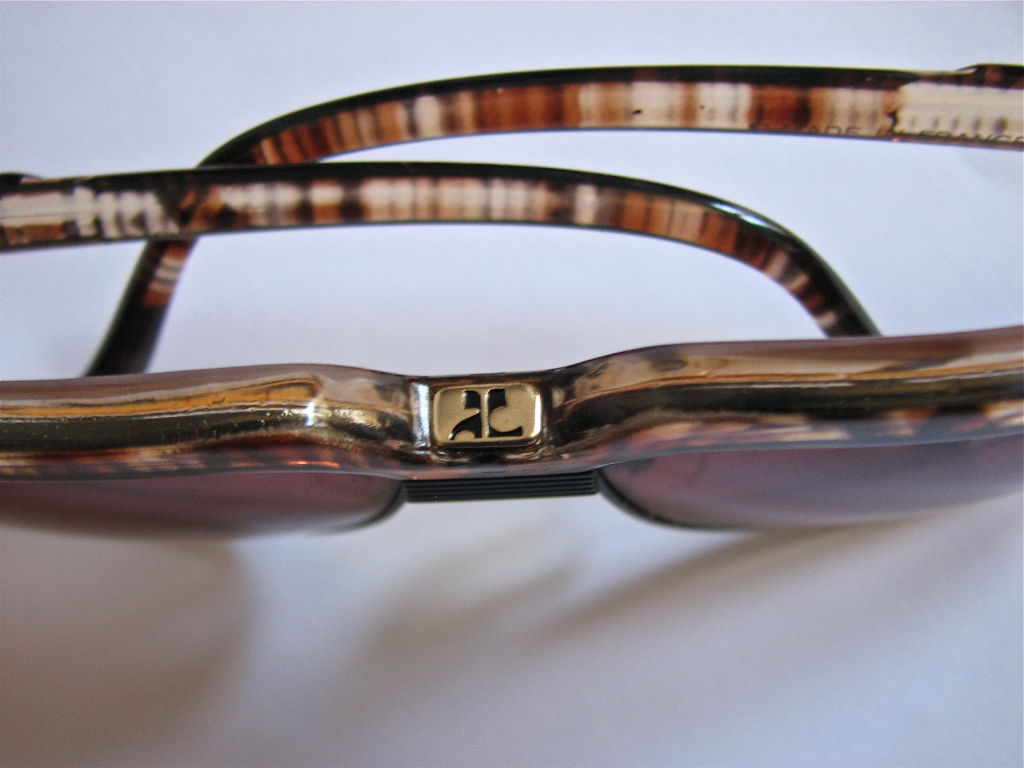 Frames are made of a unique 'tortoise' style pattern with rose lenses. Made in France. Excellent condition.
