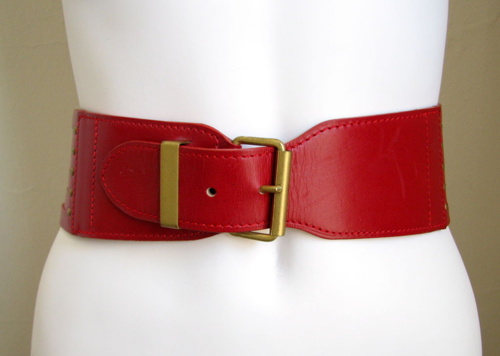 "Size 65. Fits a 24-27"" waist. Antique brass hardware. Made in France. Excellent/very good condition. Also available is the same belt in black leather."