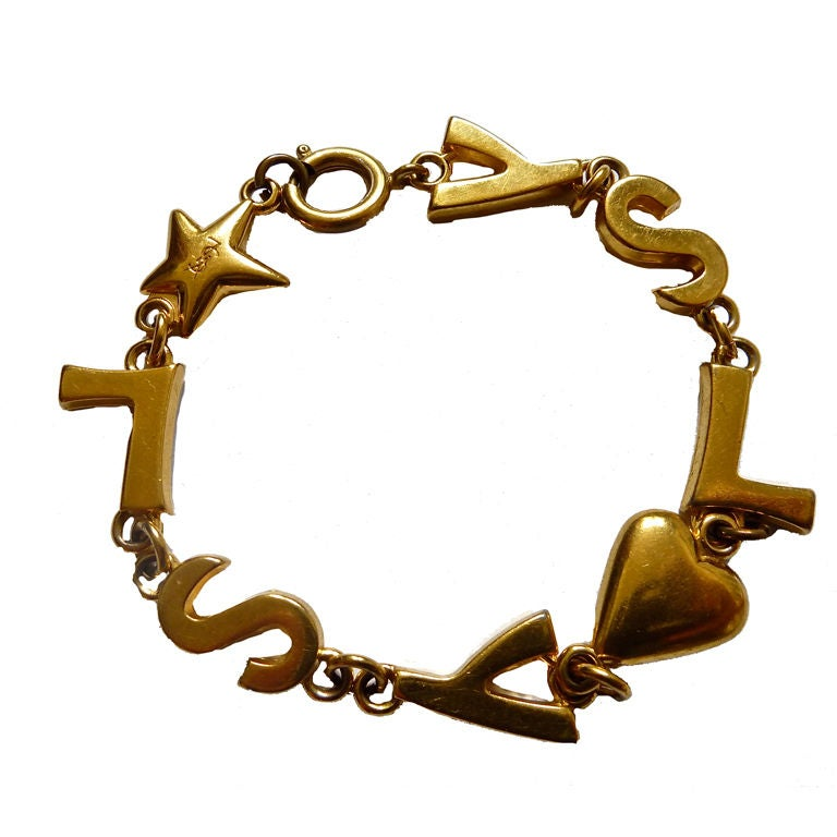Yves saint laurent gilt 39 ysl 39 bracelet at 1stdibs - Bracelet yves saint laurent ...