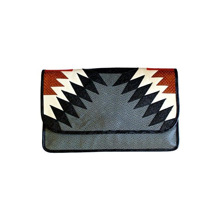 CARLOS FALCHI clutch with snakeskin trim 1