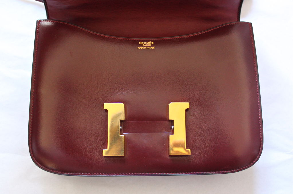 1974 HERMES burgundy 23 cm CONSTANCE with gold hardware at 1stdibs