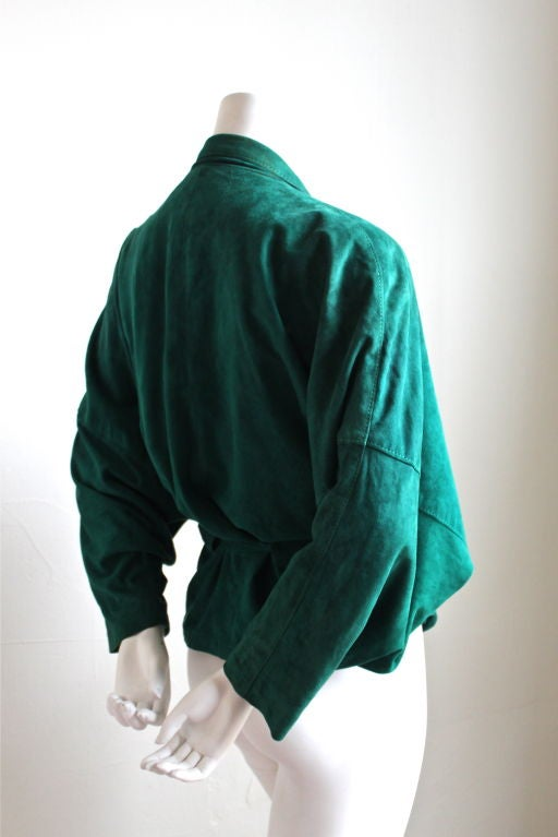 Emerald green draped suede jacket from Jean-Claude Jitrois dating to the early 1980's. Fits a size 4 to 8. Fully lined. Wrap, belt closure. Made in France. Very good condition.