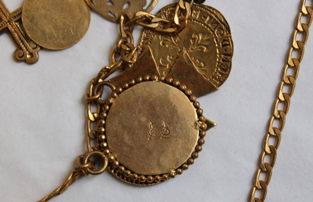 Women's YVES SAINT LAURENT gilt coins and crosses necklace For Sale