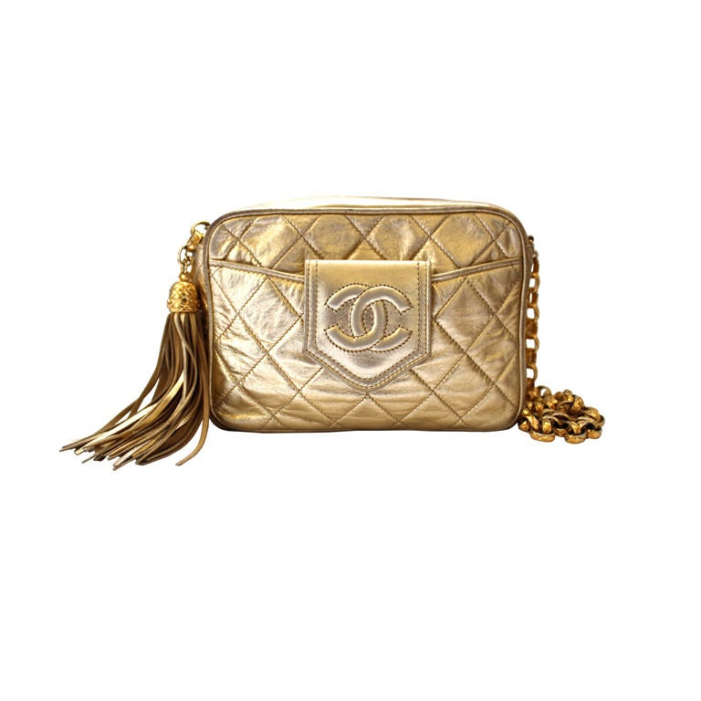 1980's CHANEL gold quilted leather bag with tassel 1