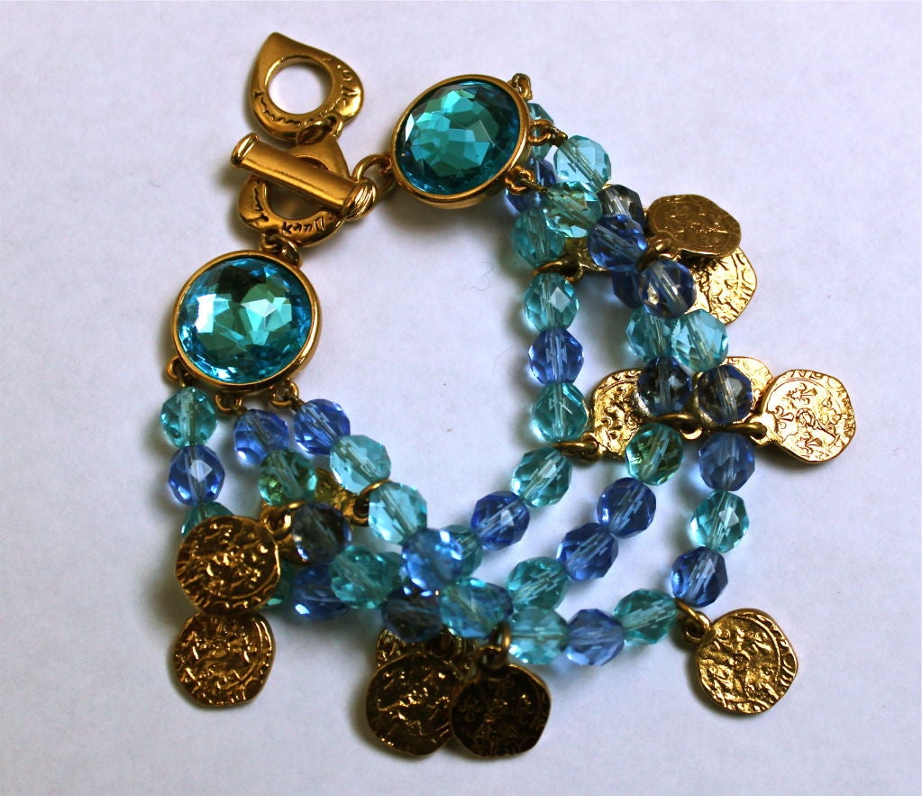 7de133078a5 Very vibrant bracelet composed of turquoise and blue faceted beads spaced  with gold coins and finished
