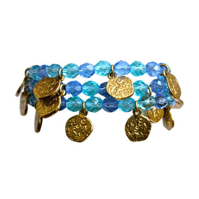 87fc4102af0 YVES SAINT LAURENT gilt coins and blue faceted bead bracelet For Sale