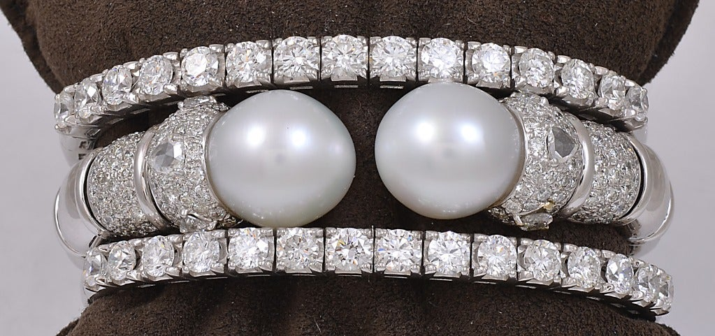 Two diamond Bangles  with 4.62 Total Weight in each one, with 15 stones.$26,000 the Set of Two.   South Sea Pearl  and Diamond Bangle with 3.00 of Diamonds $16,000