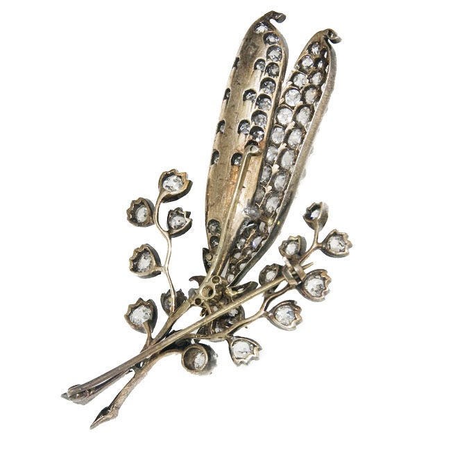 Gold top Silver Backed Brooch, Old Mine Cut Diamonds weighing a total of 4 Carats. and 6 five M.M. Pearls, possibly Natural.