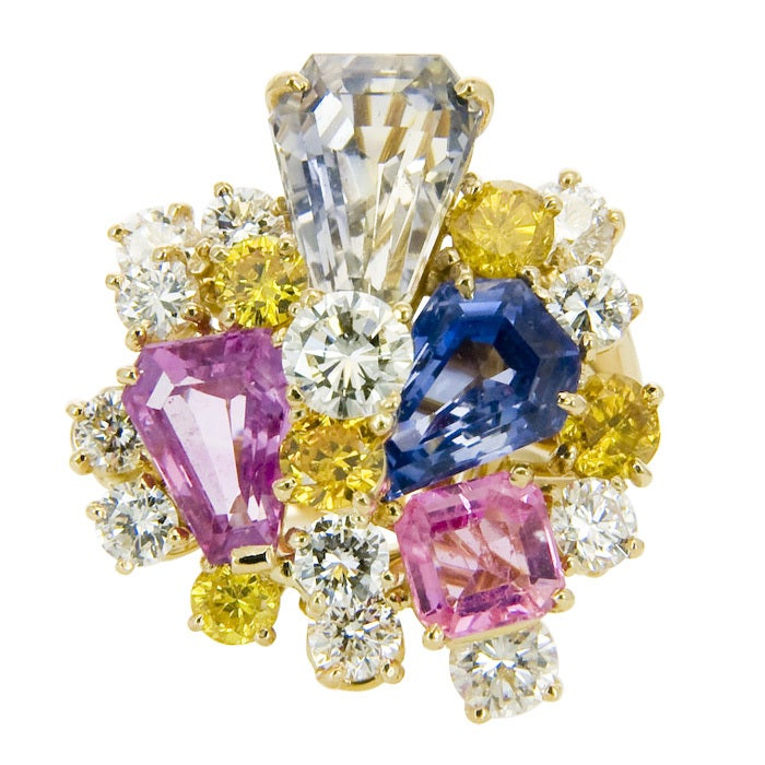 18K Yellow Gold ring by Oscar Heyman for J.E. Caldwell, set with Natural Pink and Blue Ceylon Sapphires, Further set with Natural Yellow and White Diamonds totaling 2.50 Ct. Finger size = 7 1/4.  Signed and Numbered.
