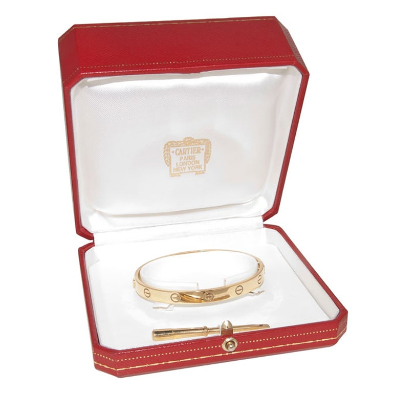 18K Yellow Gold Love Bracelet by Cartier, size 16, Original Box and Screwdriver, Stamped and Numbered.