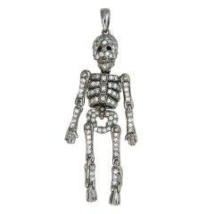 Whimsical Gold & Diamond Articulated Skeleton pendant