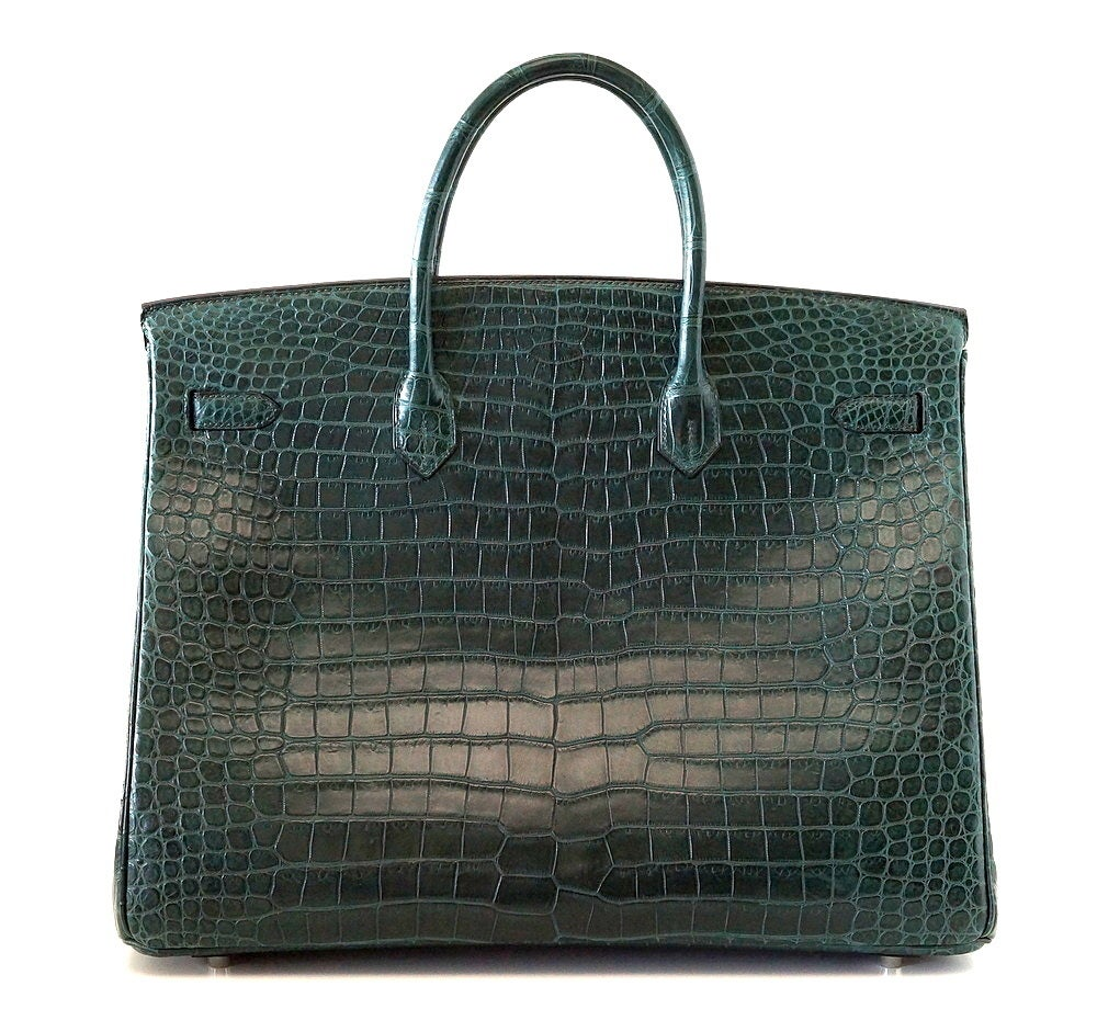 Phenomenal rich jewel toned green Hermes Birkin 40 bag Vert Fonce is chic and sophisticated in rare Matte Porosus crocodile. This stunning bag is a great neutral.   Palladium hardware.    NEW or  NEVER WORN. Comes with lock, keys, clochette,