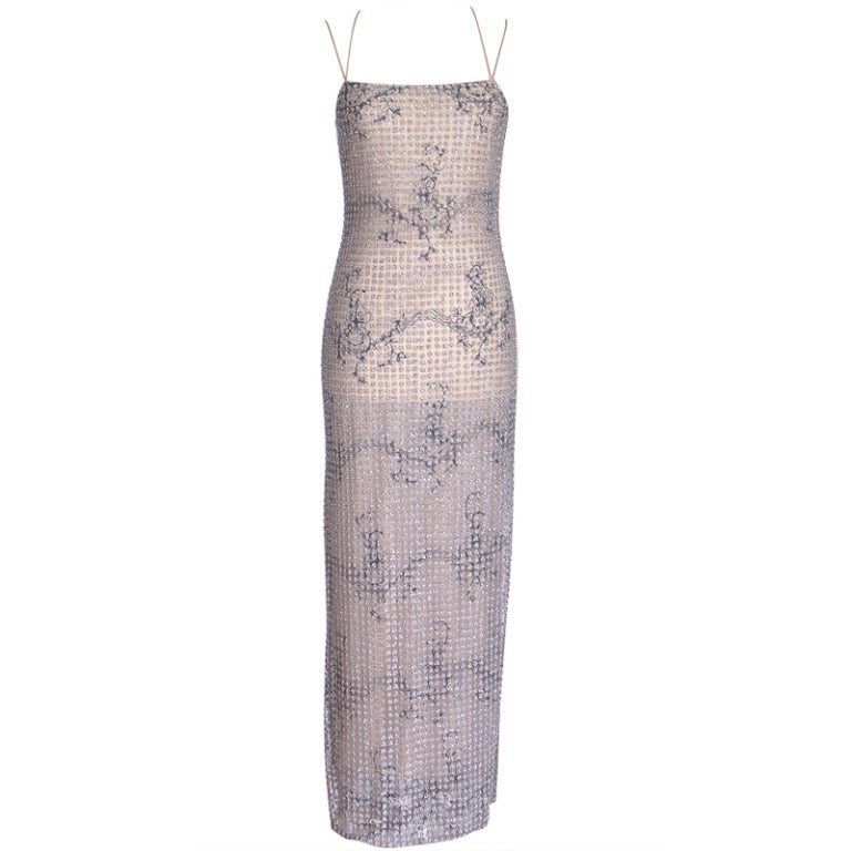 Guaranteed authentic Giorgio Armani Black Label Vintage gown that is so divinely exquisite that it can take you from the Red Carpet to the White House!  Breathtaking and the epitome of the Giorgio Armani magic. The outer semi sheer 'net' layer is