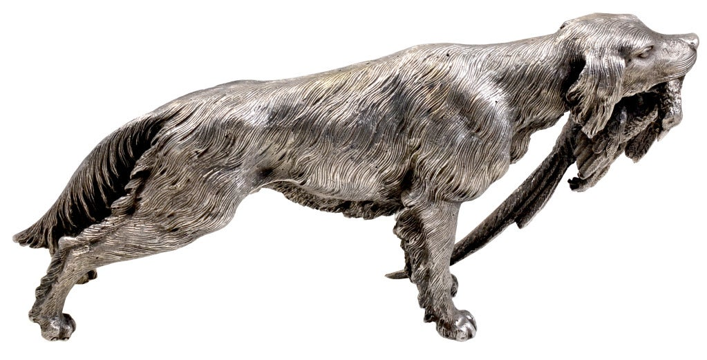 Buccellati sterling silver setter holding pheasant as his catch. One of a series of hand made dog figurines from the 1980's.They are one of a kind,each  one made was slightly different. True to life: made with exqusite detail. Alice Kwartler has