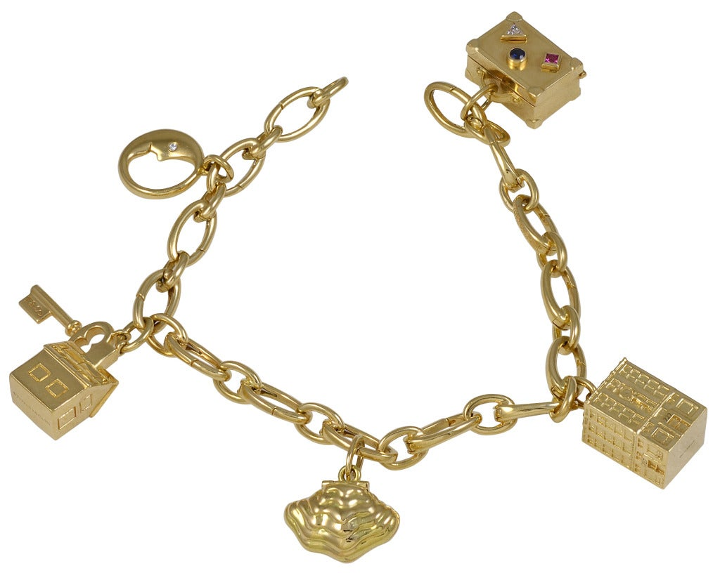 tiffanyampco gold charm bracelet with signature charms at