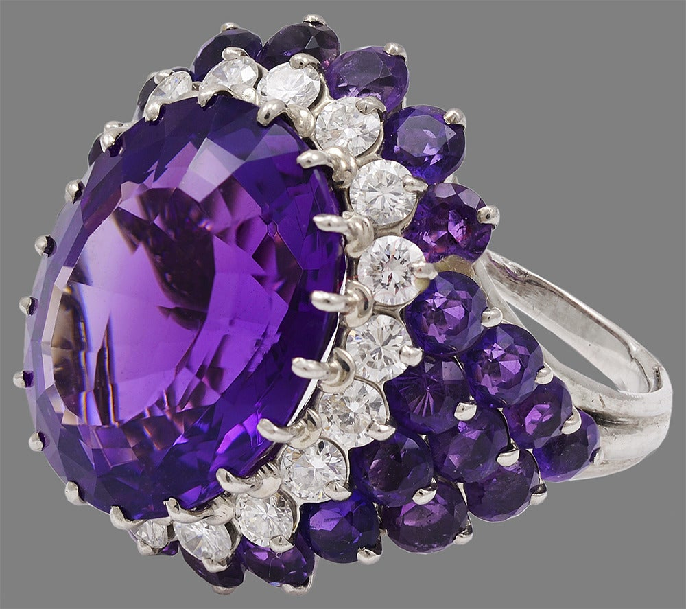 Gorgeous cocktail ring. Center amethyst is 15 cts. Vibrant purple color. 
