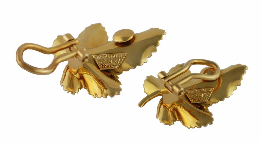 Dimensional 14K gold leaf clip earrings, made by Tiffany. Each leaf holds a full cut diamond<br /> The earrings may be made into pierced earrings if so desired