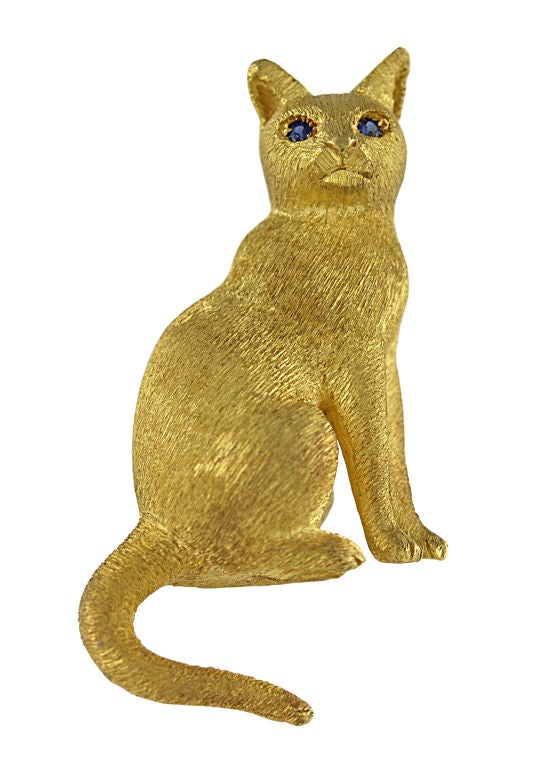 Beautiful brushed 18K gold cat pin. The finish makes the cat appear so silky. The eyes are sapphire. The cat measures 2