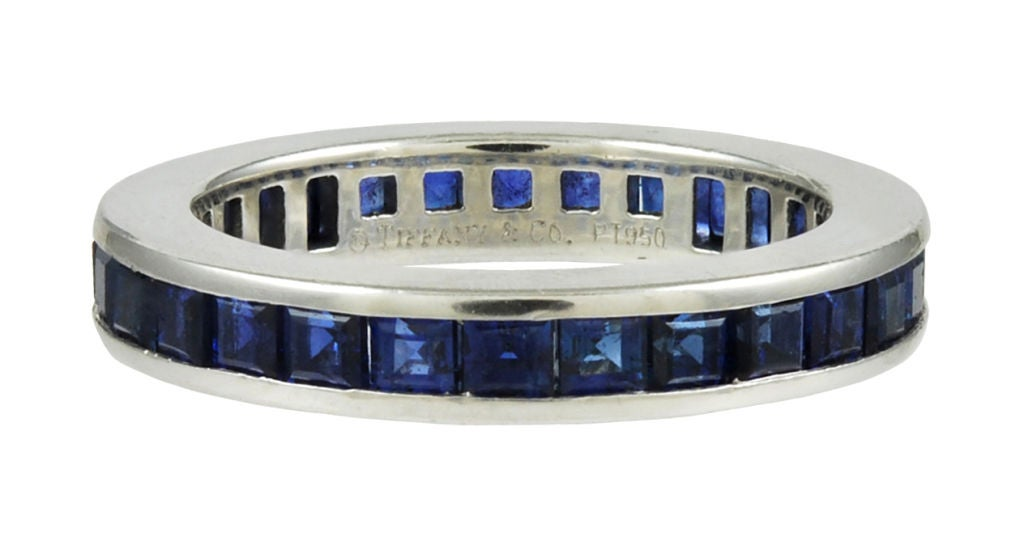Tiffany Sapphire Eternity band, set in platinum. Square cut sapphires. Fine old Tiffany quality! May be paired with JU11110799518<br /> Size 4 3/4