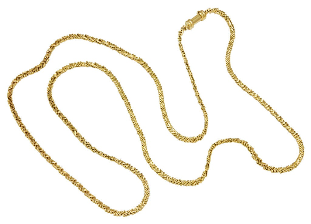 """Long flexible 18k yellow gold necklace. Made, signed and numbered by Cartier. 35"""" long. Can be worn single or doubled. Beautiful on its own or may be used to suspend another piece of jewelry. An interesting and most unusual  link."""