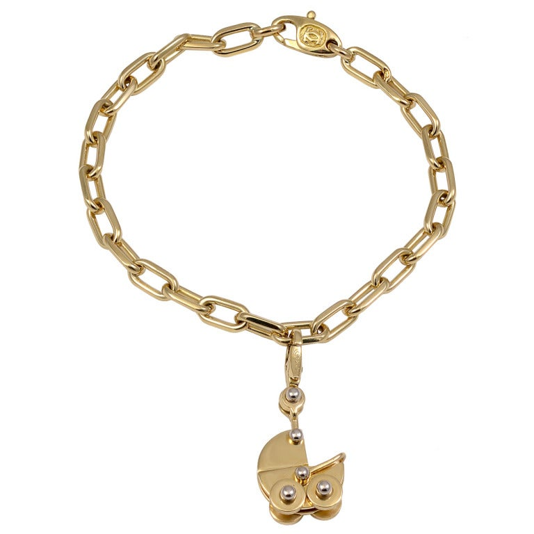 Cartier Gold Charm Bracelet With Baby Carriage For