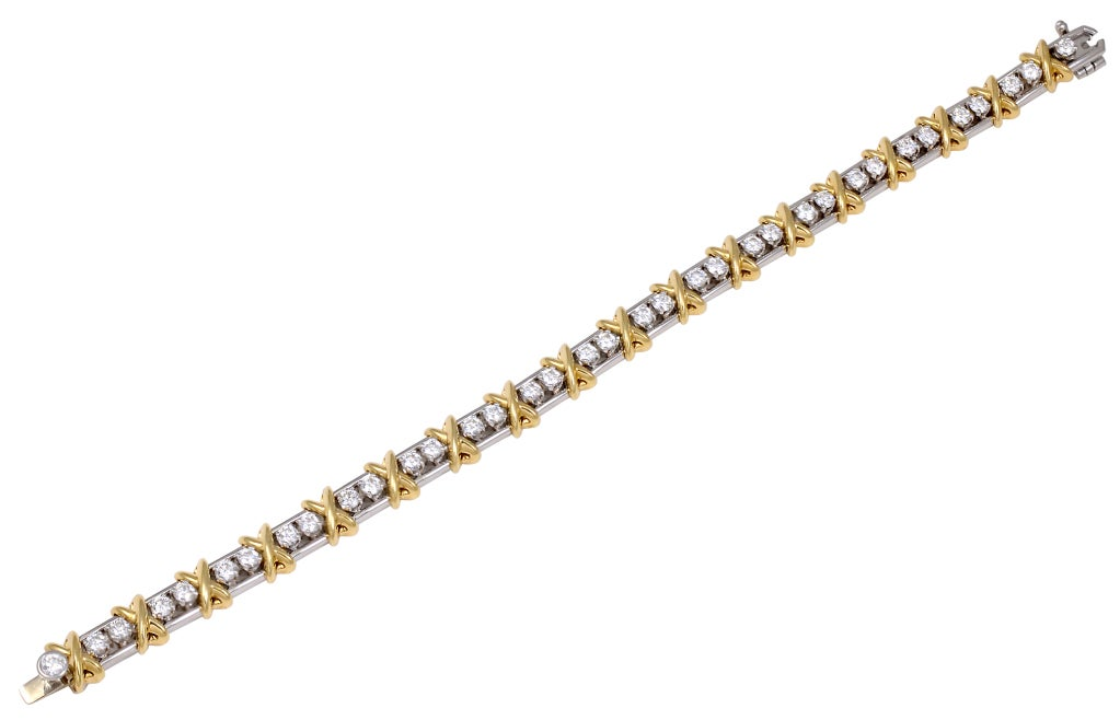 TIFFANY SCHLUMBERGER 36 stone Bracelet. Beautiful diamond bracelet, signed Tiffany&Co Schlumberger. Brillant cut round diamonds 2.95cts set in platinum and 18k gold, interspersed with gold x's. Classic Tiffany bracelet that stands alone or looks