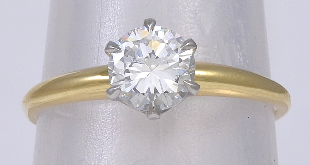 Classic TIFFANY & CO engagement set in 18k yelow gold and platinum. Brilliant cut stone .75cts E color, VS2. This ring is size 6 1/4 and may be easily sized. Pristine and beautiful.