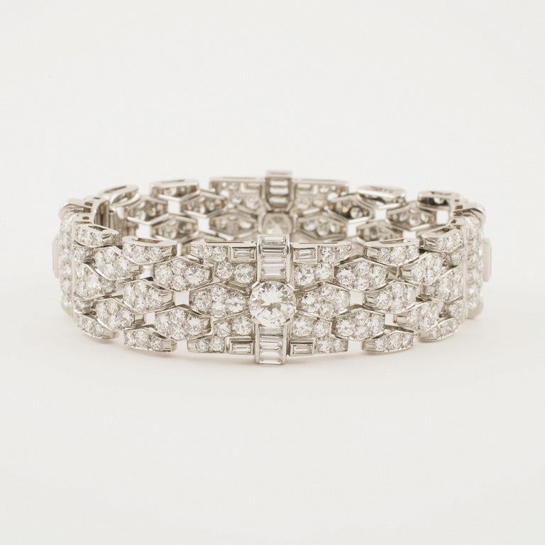 A French Art Deco platinum bracelet with diamonds by Bulgari. The bracelet has 294 round-cut diamonds with an approximate total weight of 16.00 carats, 45 baguette diamonds with an approximate total weight of 6.00 carats,  2 round-cut diamonds with