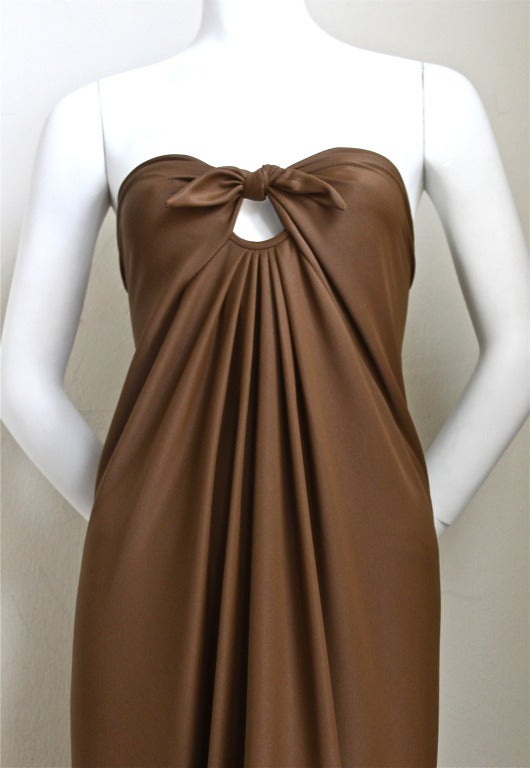 Very rare cocoa brown spiral cut jersey gown designed by Halston dating to 1976. Size label has been removed however this best fits a size 4-8. Unstretched measurements: bust 32