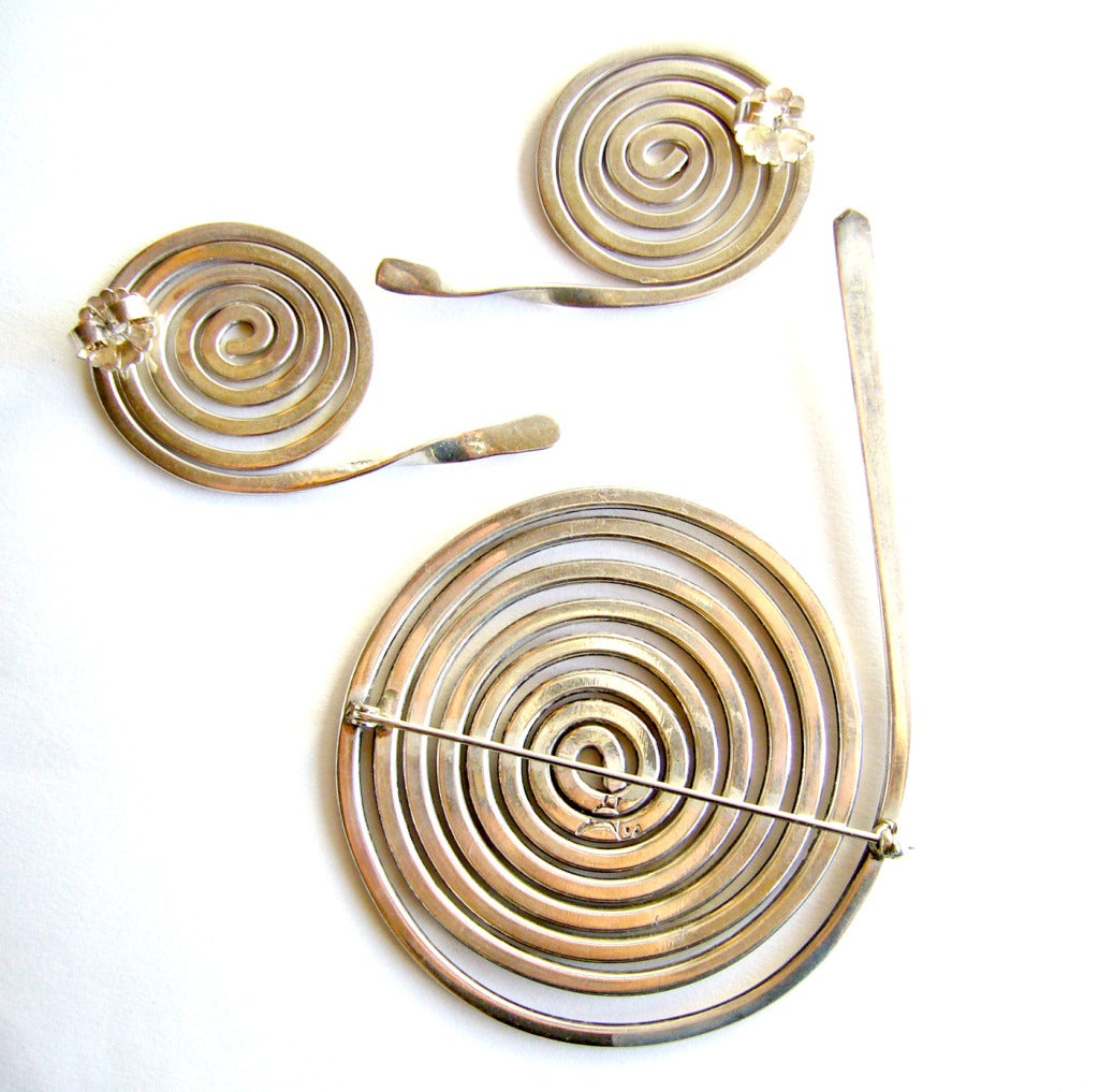 """A large scale, sterling silver coiled snake brooch and earrings set of Southwest origin.  Brooch measures 4"""" by 2 3/4"""" while the matching pierced earrings measure 2 1/2"""" by 1 1/4"""".  Signed with an unknown bird hallmark and tests"""