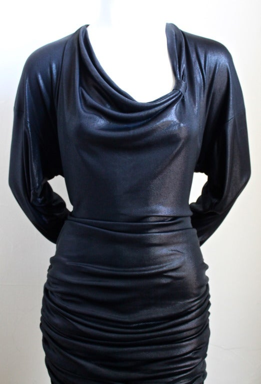 "Metallic black slightly dress with rushing from Patrick Kelly dating to the 1980's. Fits a US 6-8. Measurements are difficult to take because the dress is designed to drape. The bust is approximately 38"", waist 31-32"" and length is 36"" long. Zips up"