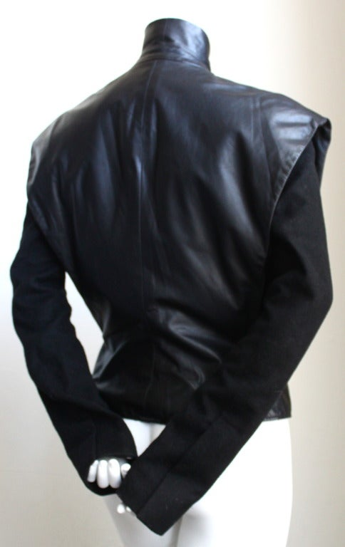 Black lambskin leather jacket with wool sleeves designed by Nicolas Ghesquiere for Balenciaga fall 1999. This is the actual jacket worn on the runway. It was given as a gift to the runway model from Nicolas Ghesquiere. No label or size because the