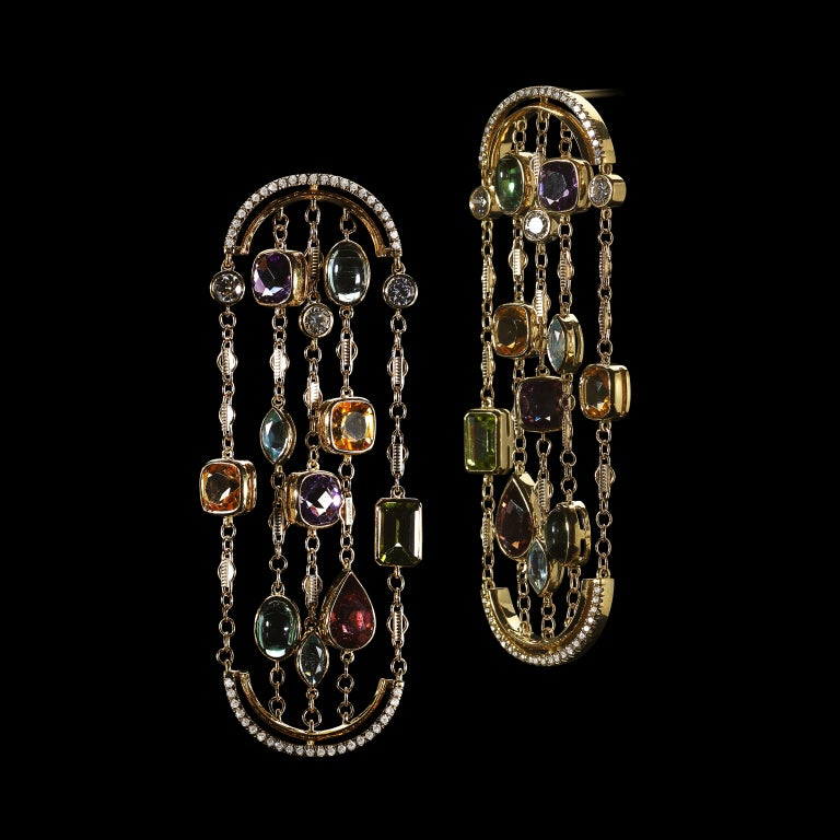 These arched earrings feature a mixture of Brillian and fancy shape Aquas, Citrines, Tourmalines, Amethysts and Peridots. Earrings are set in 18 karat yellow gold and suspended by arches detailed with Alexandra Mor's signature floating Diamond