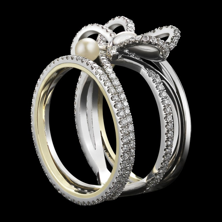 Contemporary Pearl Diamond Platinum Bow Ring For Sale At