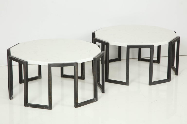Elegant pair of crenelated tables, patinated wrought iron and travertine, France, mid-1950s. Price for one.