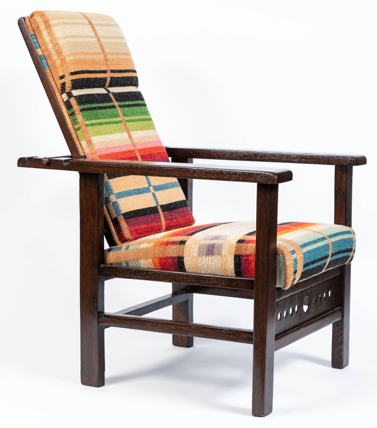 Antique oak child's Morris style chair, circa 1910. Wood has been newly refinished with new upholstery in a wool blanket.