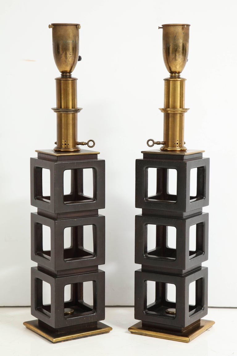 Large pair of stacked cubes lamps by Steiffel, Mahogany body on brass base with original fitting. Can be custom rewired on request. Sold as a pair.