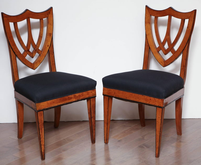 Pair of Viennese side chairs in fruitwood, circa 1830.